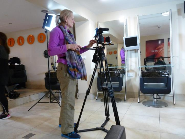 Moira O'Brien filming for Dress for Success at Ikon Hair Studio.
