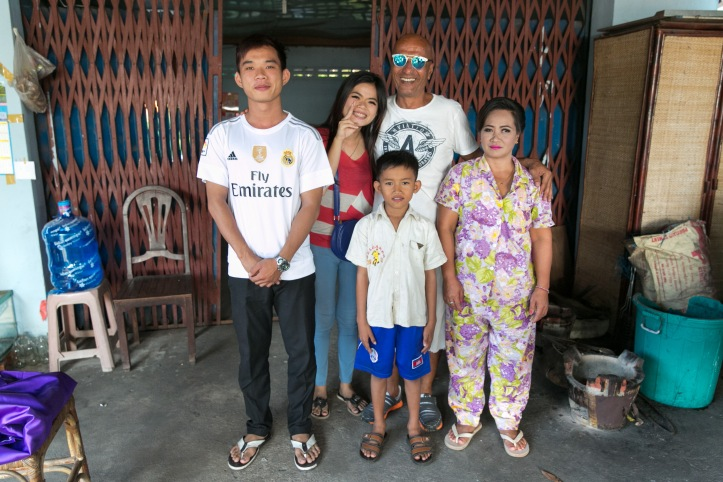 Momo with Grek, Ah Cheng, Chay and Ek, who is deaf. Their rent and school fees are paid for through fundraising in St Luke's. Photo: Rory Coomey